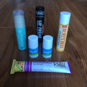 Battle of the Balms: Contenders include Rooted Beauty's Lip Butter, Clean George's Chill out and Stuffed up, The Honest Co's Organic Lip Balm in Lavender Mint, Doctor Lip Bang's Lip Freak, Burt's Bees New Hydrating Lip Balm