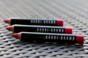 Bobbi Brown's Multitasking Art Stick comes in many shades. Feature here are Harlow Red, Sunset Orange and Electric Pink